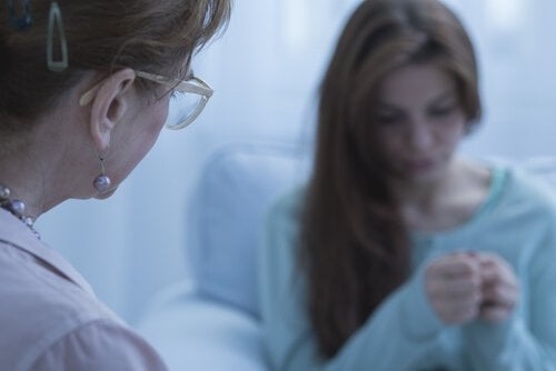 A worried female patient with a healthcare provider.