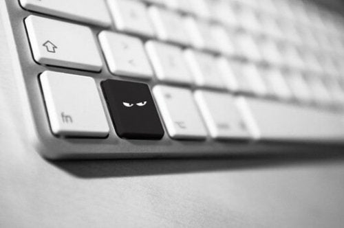 A computer key with a mean face.