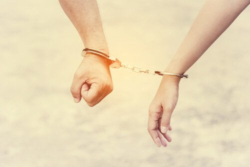 A couple connected by handcuffs.