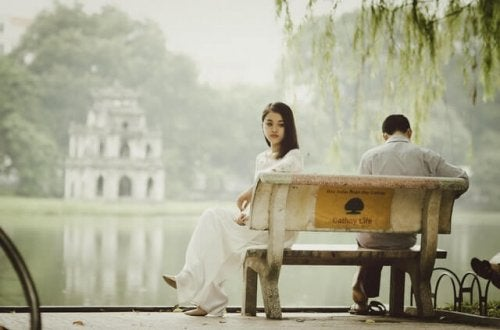 Girl sitting on a bench feeling lonely.