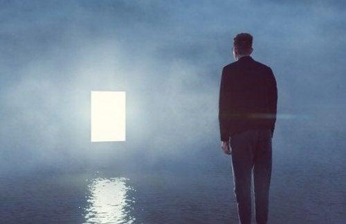 A man looking at an open door.