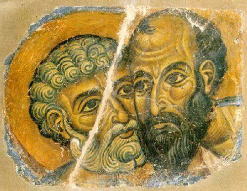 Two men pressing their faces against each other's.