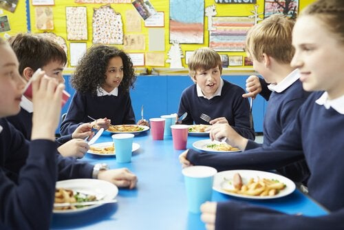 Children can learn table manners in the school cafeteria.