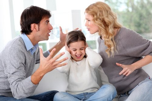 Child covering her ears while her parents fight.