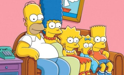 The Simpson family sitting on the couch.
