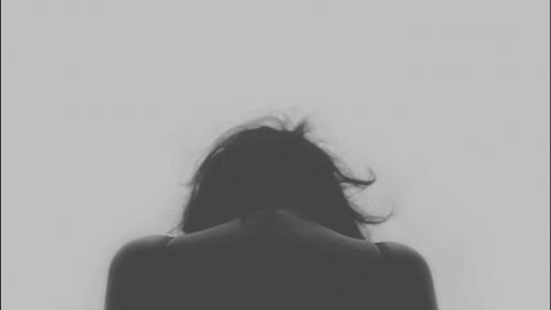 Woman looking down.