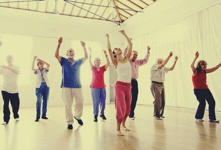 A group of older people in a dance class.