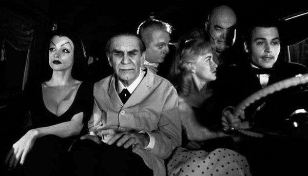 Johnny Depp (as Ed Wood) driving a car crammed in with the rest of the cast.
