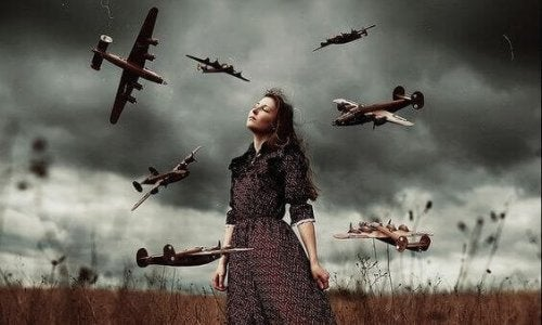 A woman standing in a field with a stormy sky behind her, surrounded by miniature airplanes in flight.