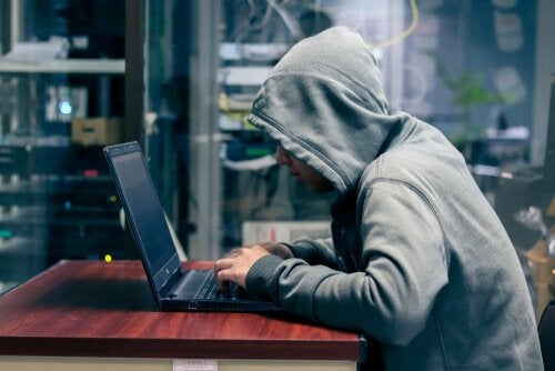 Social media troll working on computer.