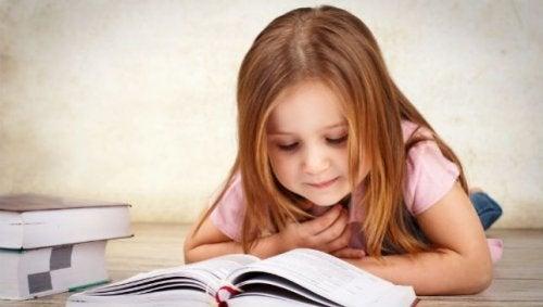 A little girl reading an inspiring story.