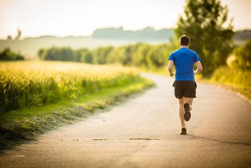 A man running who knows that ten minutes of exercise will make him happier.