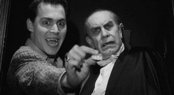 Johnny Depp holding a pair of false teeth in his hand in the Ed Wood movie.