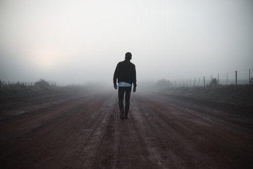 A man walking through the fog.