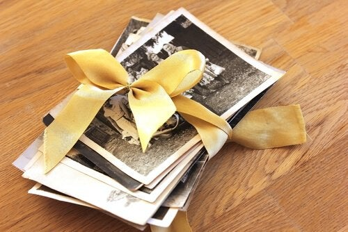 Photos of positive memories tied together with a ribbon.