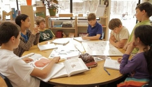 A group of kids doing school work.