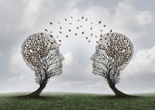 Two trees in the shape of human heads with birds between.