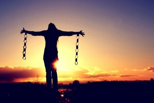 A woman freeing herself from her chains.