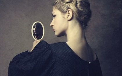 A narcissistic woman looking at herself in a mirror.