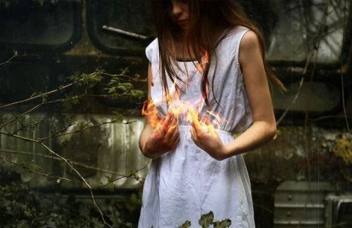 A woman holding fire.
