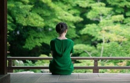 A woman in a green dress.