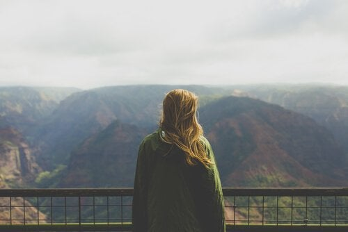 A woman looking at mountains.
