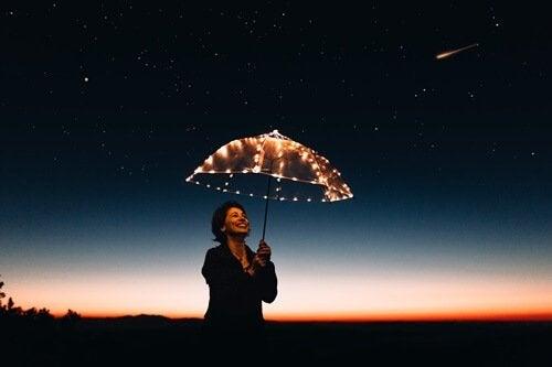 A woman with an umbrella.