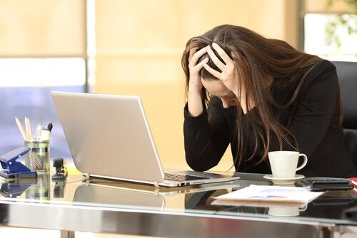 A stressed woman at her desk.