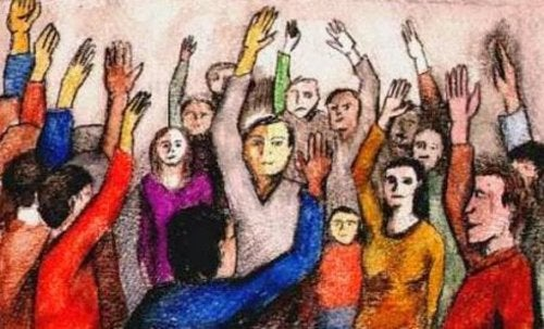 Group of people identifying with one another by raising their hand.