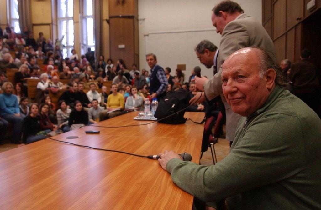 Imre Kertész at a conference.