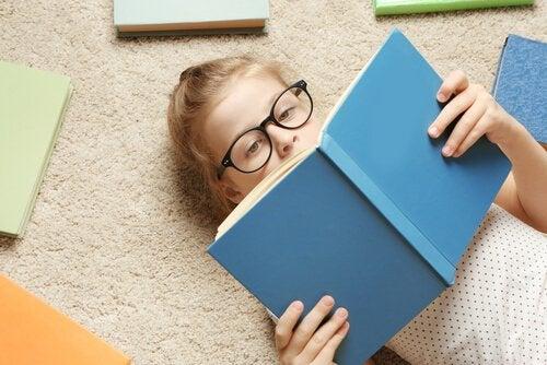 A little girl reading.