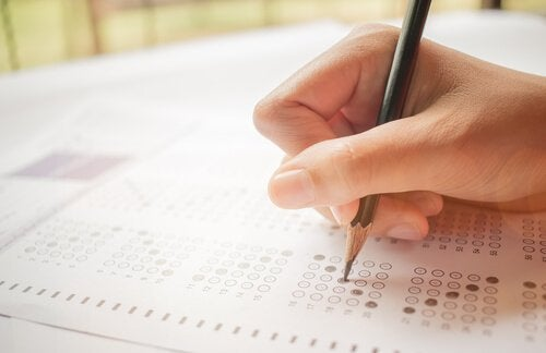 A person filling out an answer sheet.