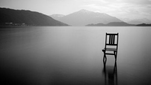 A chair on an empty lake.