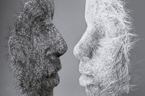 An image of a black mask and white mask facing each other symbolizing the idea that we can change our personality.