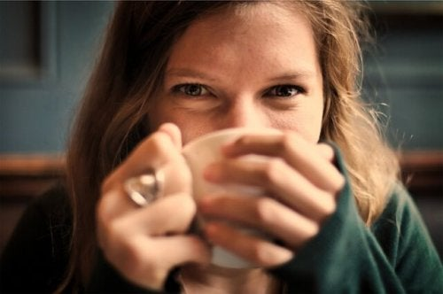 A woman drinking some tea.
