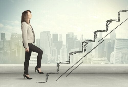 A businesswoman going up the stairs.
