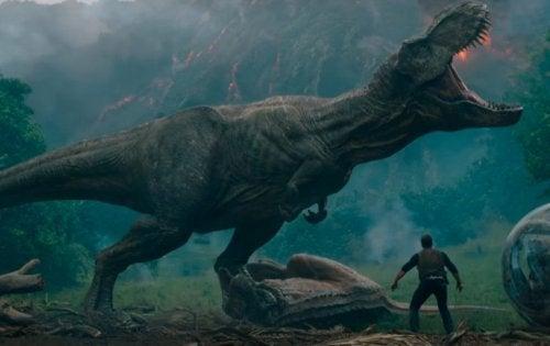 A T. rex and a man.