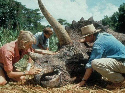 Scientists with a wounded dinosaur in the movie Jurassic Park.