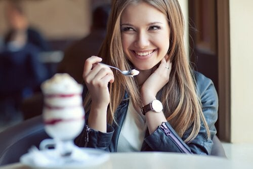 A woman eating ice cream.