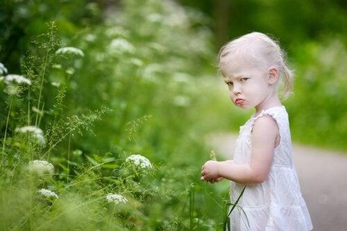 a little girl feeling disgruntled