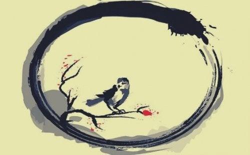 A bird inside the ensō circle.