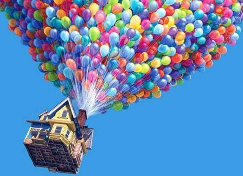 The film 'Up' represents the act of honoring the memory of a loved one. In this photo, the house where Ellie and Carl lived is being transported to Paradise Falls with the help of balloons.