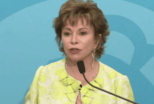 Isabel Allende answering questions during a conference.