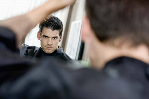 A narcissist looking at himself in the mirror.