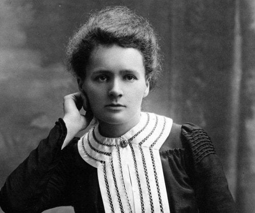 A young Marie Curie posing.