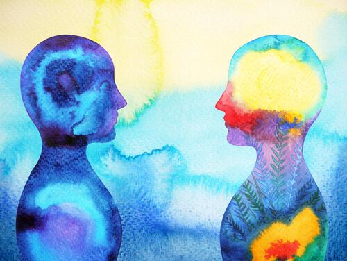 An illustration of the outline of two people painted in tie-dye colors showing them looking at each other face to face.