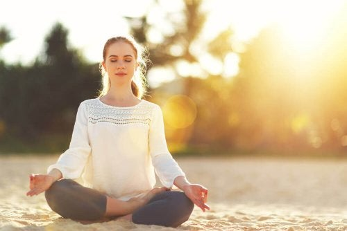 Woman meditating to reduce daily worries.
