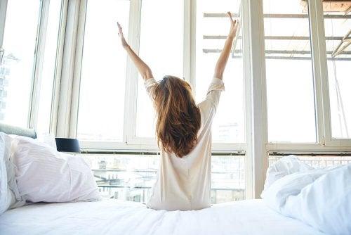 A woman waking up.