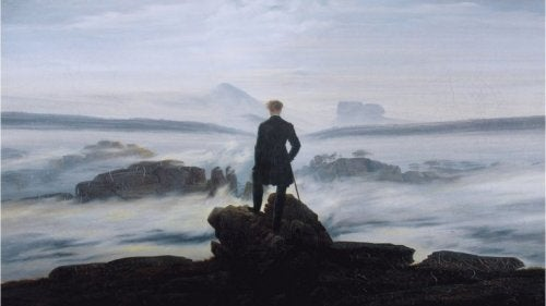 A painting by Kaspar Friedrich of a man looking at the sea.