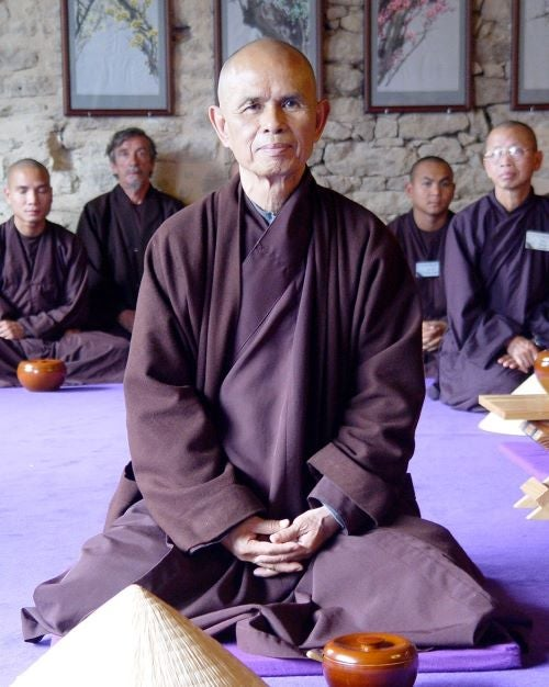Thich Nhat Hanh sitting in class.